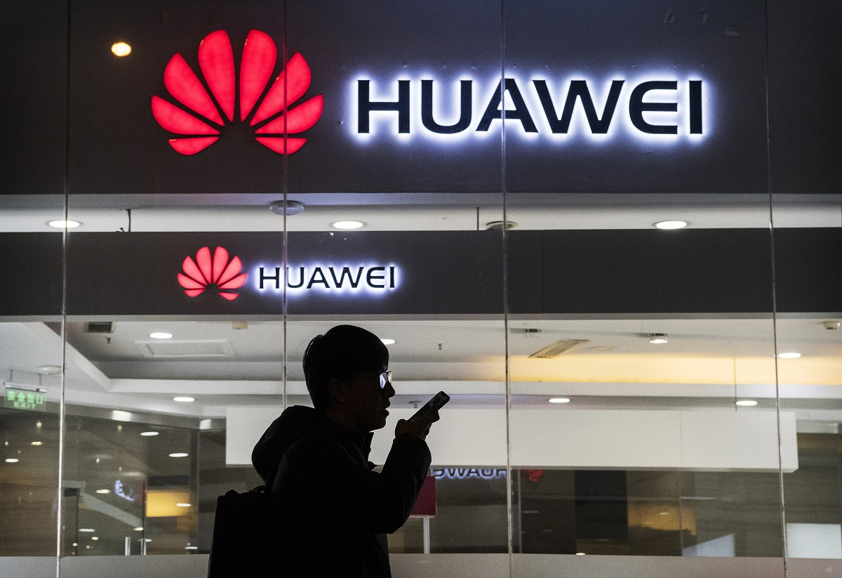 A pedestrian talks on the phone while walking past a Huawei Technologies Co. store on January 29, 2019 in Beijing, China. The U.S. Justice Department filed a host of criminal charges against Chinese telecoms giant Huawei and its chief financial officer, Meng Wanzhou, including bank fraud, violating sanctions on Iran, and stealing robotic technology. Huawei denied committing any of the violations and rejected criminal claims against Meng, the daughter of Huawei founder Ren Zhengfei, who was arrested in Canada in December last year
